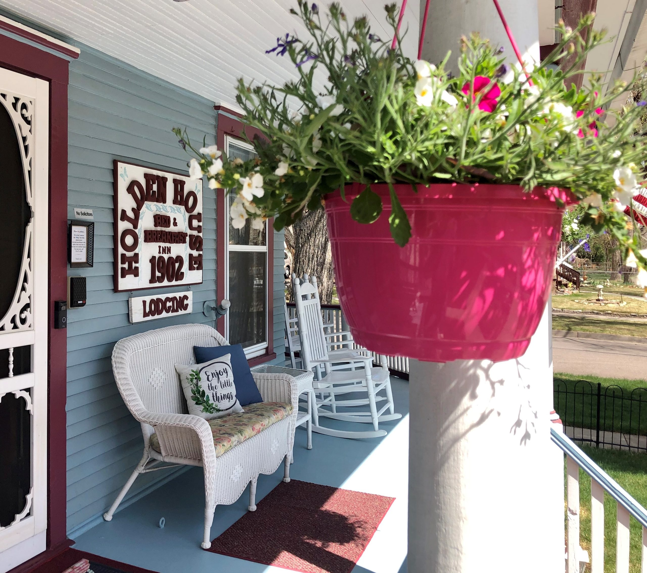 Holden House includes a welcoming front porch